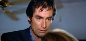 Timothy Dalton's expression when looking at Della after her death